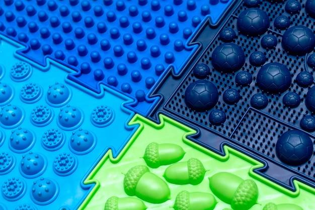 Kleurrijke het patroon van massage orthopedische matten dichte omhooggaand als achtergrond