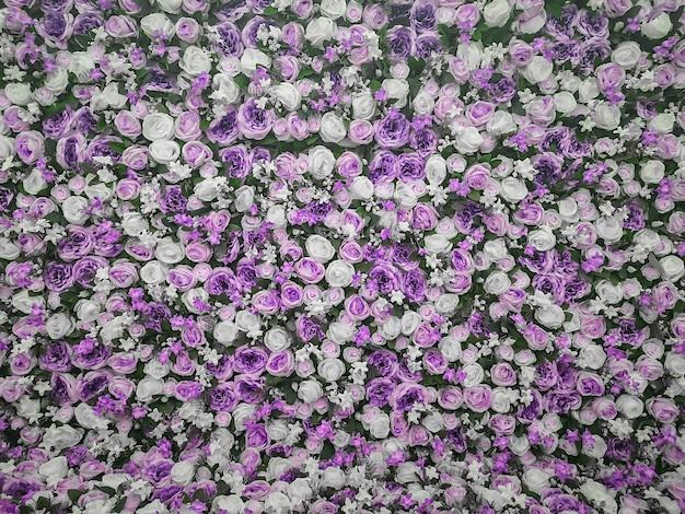 Kleurrijke kunstbloemen muur achtergrond
