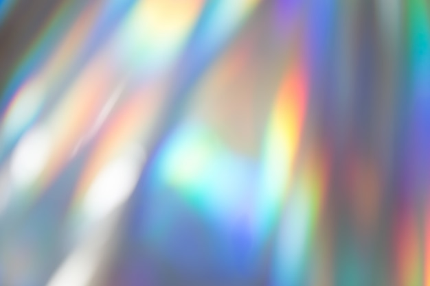 Kleurrijke levendige holografische pastel folie achtergrondstructuur. giftige rave, feestelijke achtergrond.