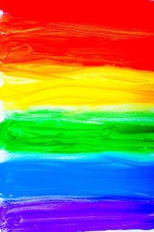 Kleurrijke lijnen horizontaal getekend met verf in de vorm van een regenboog op een witte achtergrond bovenaanzicht...