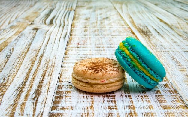 Kleurrijke macaron of macaroon op vintage pastel background