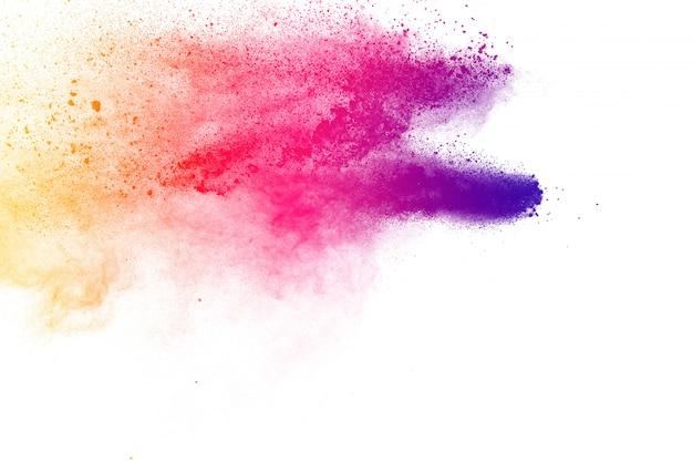 Kleurrijke poederexplosie. abstracte pastelkleurstofdeeltjes spatten.