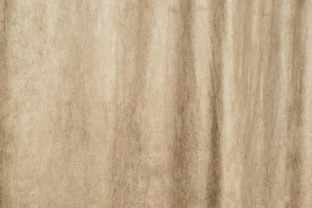 Kleurrijke stoffentextuur als achtergrond van een dik muurgordijn