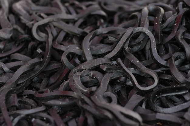 Kleverig lintsuikergoed, zwarte achtergrond