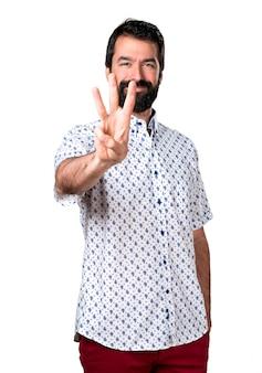 Knappe brunette man met baard tellen drie