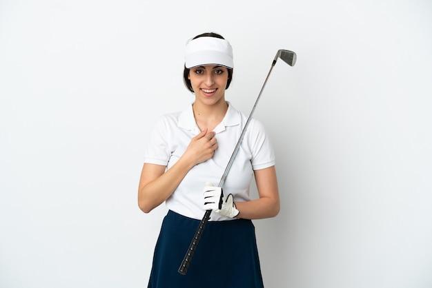 Knappe jonge golfer speler vrouw geïsoleerd op een witte achtergrond met verrassing gezichtsuitdrukking