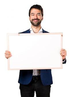 Knappe man met een lege plakkaart