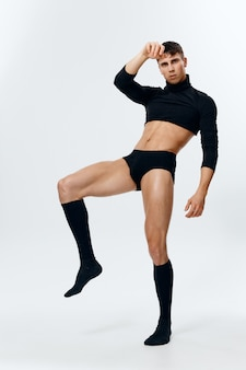 Knappe spierman bodybuilder fitness kniekousen trui