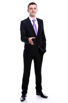 Knappe zakenman die handdruk aanbiedt