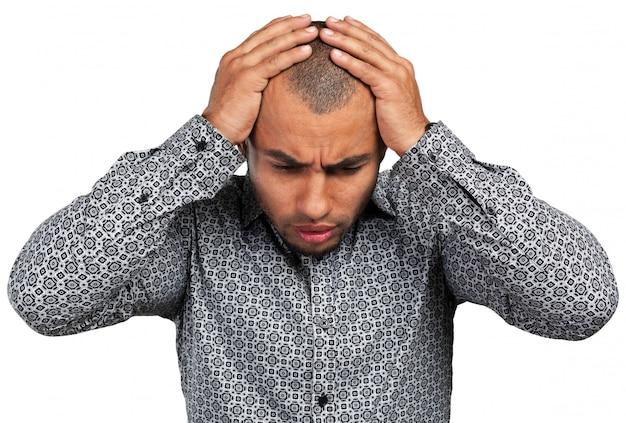 Knappe zakenman met een depressieve uitdrukking
