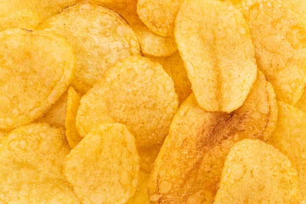 Knapperige chips snack textuur achtergrond, bovenaanzicht.