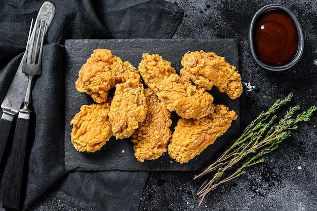 Knapperige kentucky fried chicken frieten