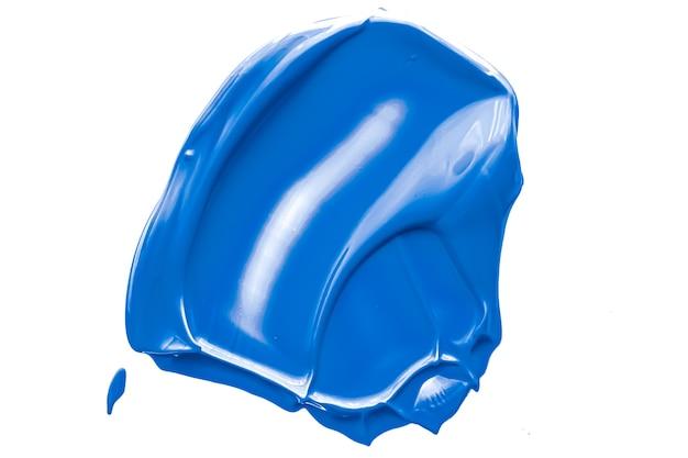Kobaltblauw schoonheid cosmetische textuur geïsoleerd op een witte achtergrond vlekkerige make-up uitstrijkje of cosmetica p...