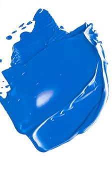 Kobaltblauw schoonheid cosmetische textuur geïsoleerd op een witte achtergrond vlekkerige make-up uitstrijkje of cosmetica p... Premium Foto