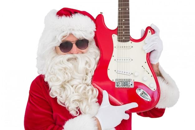 Koele santa die elektrische gitaar toont