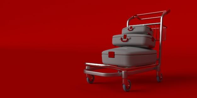 Koffer op wielen geïsoleerd op rood