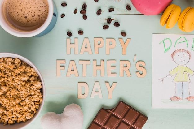 Koffie en eten in de buurt van happy father's day schrijven en tekenen