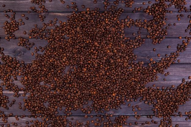 Koffiebonen achtergrond. bovenaanzicht met kopie ruimte