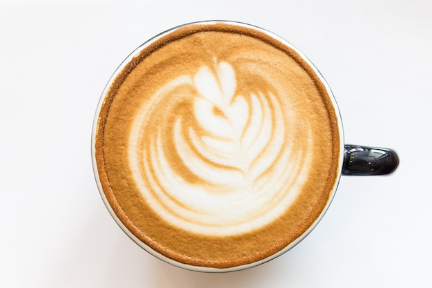 Koffiekopje latte art op tafel