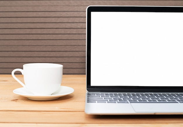 Koffiekopje met laptop