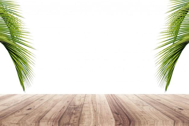 Kokosnotenbladeren op een gele achtergrond om producten te tonen