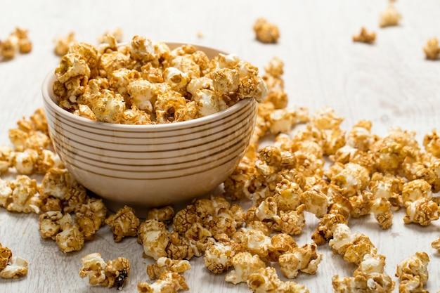 Kom met popcorn