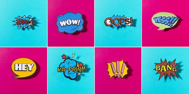 Komische gekleurde geluidspictogrammen die voor web op blauwe en roze achtergrond worden geplaatst