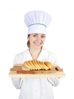 Kook bij het snijden van brood