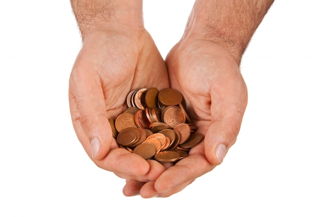 Koperen euromunten in handen