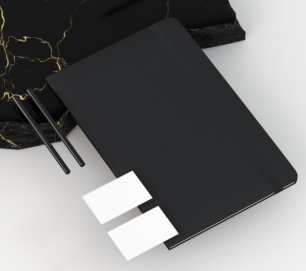 Kopieer ruimte visitekaartje en zwarte notebook