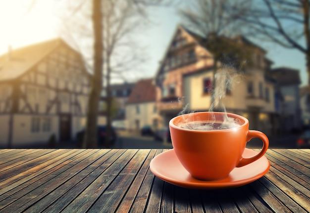 Kopje koffie op de achtergrond van de stad