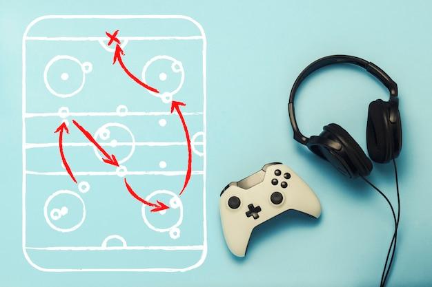 Koptelefoon en gamepad met tekening met de tactiek van het spel