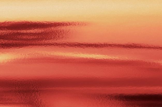 Koraal goud papier textuur. abstracte gouden folie metalen achtergrond.