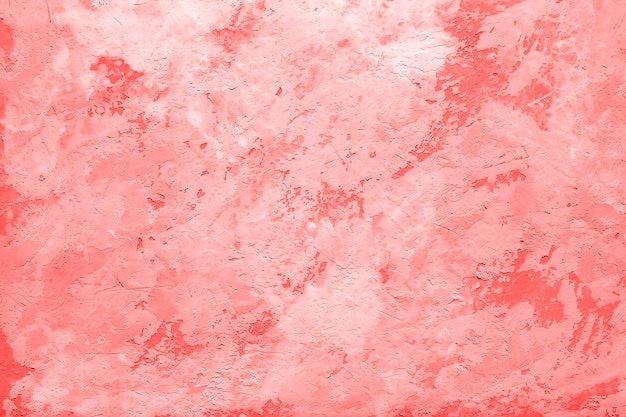 Koraal kleur abstracte achtergrond of decoratieve textuur van oude gepleisterde muur, gips.