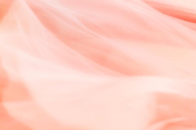 Koraalroze stof textuur achtergrond voor blog banner