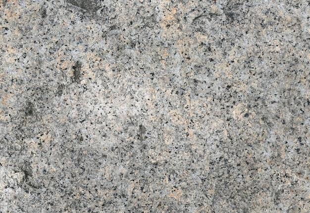Korrelige oppervlakte van de achtergrond van de graniettextuur.