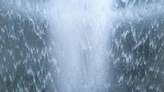 Krachtige stroom van waterval Achtergrond van de waterstroom van de golfaard, macromening.