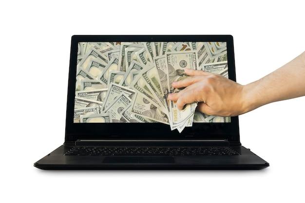 Krijg geld van online zaken met amerikaanse dollar in de hand. bedrijfsconcept. hand trekken geld uit de laptop geïsoleerd op een witte achtergrond. inkomsten op internet. winst uit internetzaken