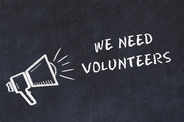 Krijtbord schets met luidspreker en zin dat we vrijwilligers nodig hebben