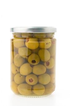 Kruik van het glas met olijven