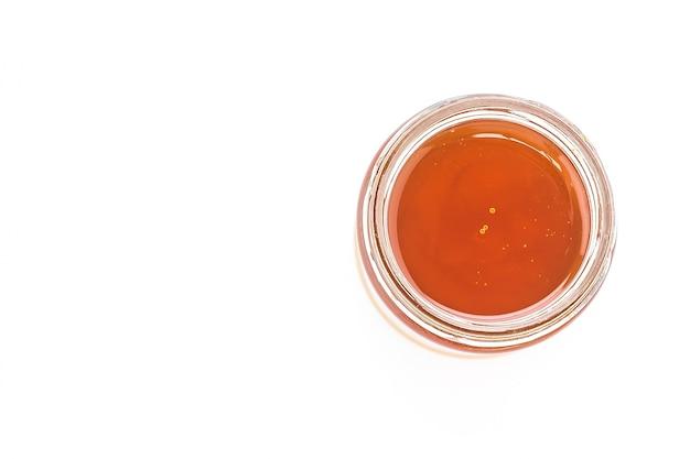 Kruik van het glas met oranje marmelade