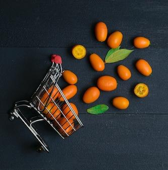 Kumquat winkelwagen mand donker bovenaanzicht