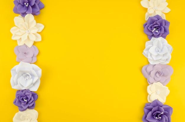 Kunstconcept met bloemenframe en gele achtergrond