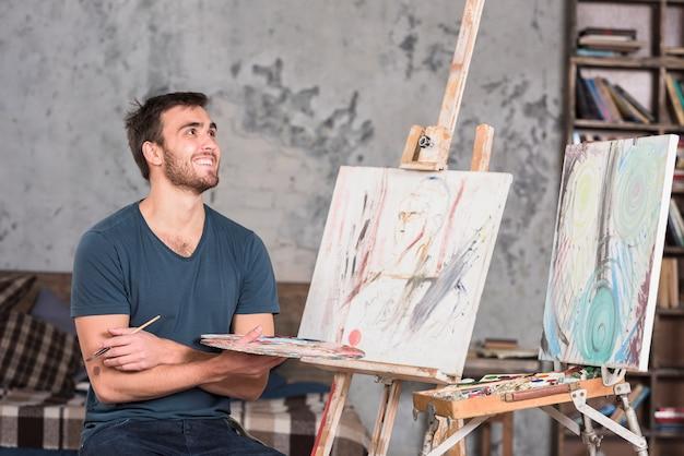 Kunstenaar met kleurenpalet