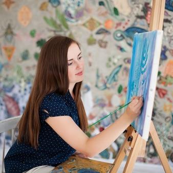 Kunstenaar schilderij foto op canvas whith aquarellen