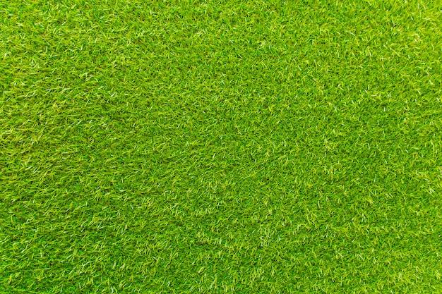 Kunstmatig groen gras. de achtergrond is groen.