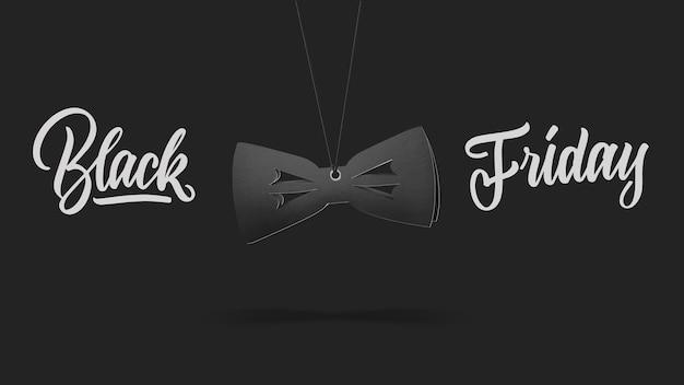 Label in vorm vlinderdas op hoge heuvel gemaakt van karton op een grijze background.a kalligrafische tekst zwarte vrijdag en verkoop luxe premium stijl concept
