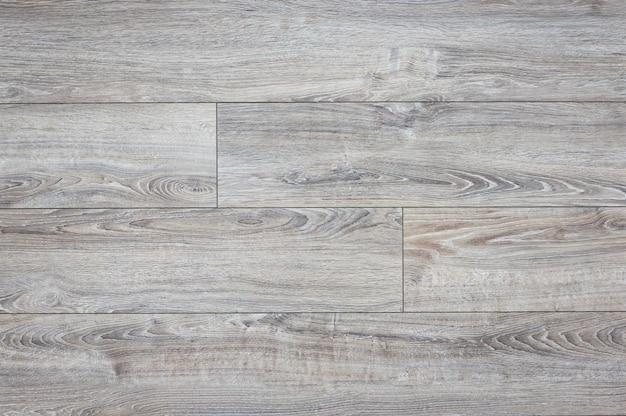 Laminaat achtergrond. houten laminaat- en parketplanken voor de vloer in het interieur. textuur en patroon van natuurlijk hout