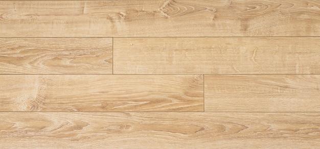 Laminaat achtergrond. houten laminaat en parketplanken voor de vloer in interieurdesign. textuur en patroon van natuurlijk hout