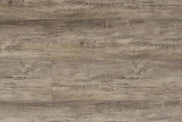 Laminaat achtergrond. houten laminaat en parketplanken voor de vloer in interieurinrichting. textuur en patroon van natuurlijk hout. .